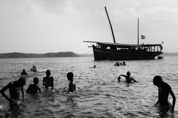The young frequent the creek mostly on afternoons and weekends. The dhow, Musafir, is a project by a community of foreigners(travellers) who built it in Lamu with the help of local craftsmen. Biko Wesa, Kenya. 2018.