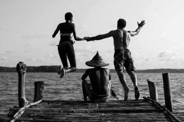 Achieng and Ivan jump in the creek as Godi sits. The Creek is popular with friends and lovers. Biko Wesa, Kilifi. 2015