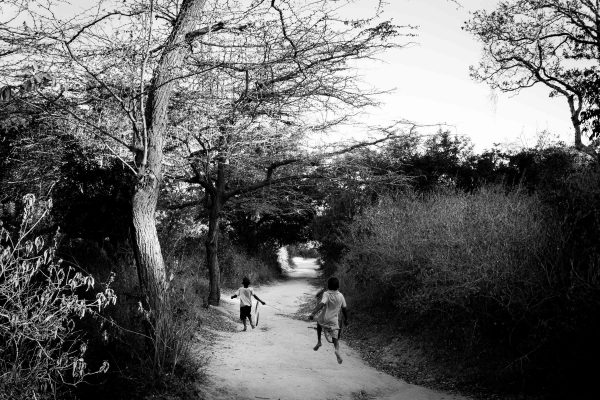 Wheeling down one of the public paths to the Creek. Biko Wesa, Kenya. 2018.